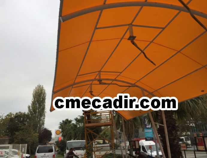 turuncu renkli otopark çadırı